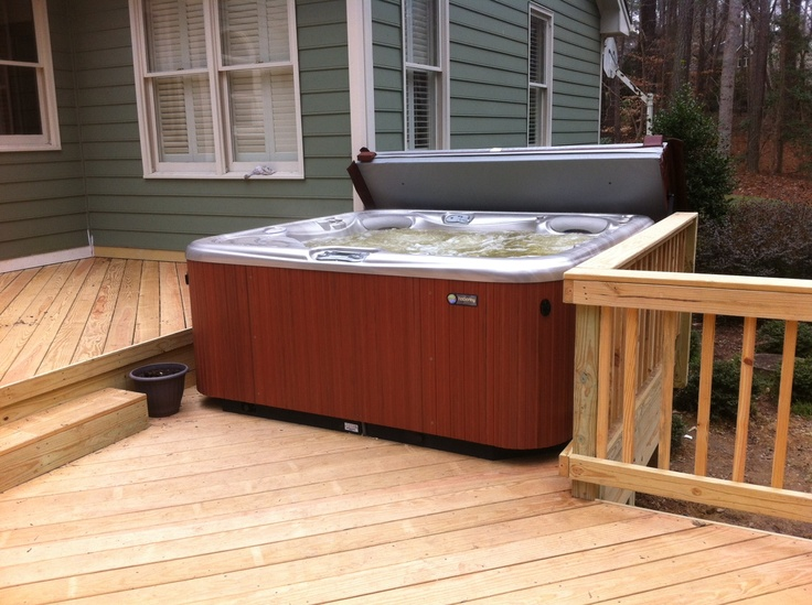 Hot spring aria installed on a custom deck with a cover for Custom deck plans