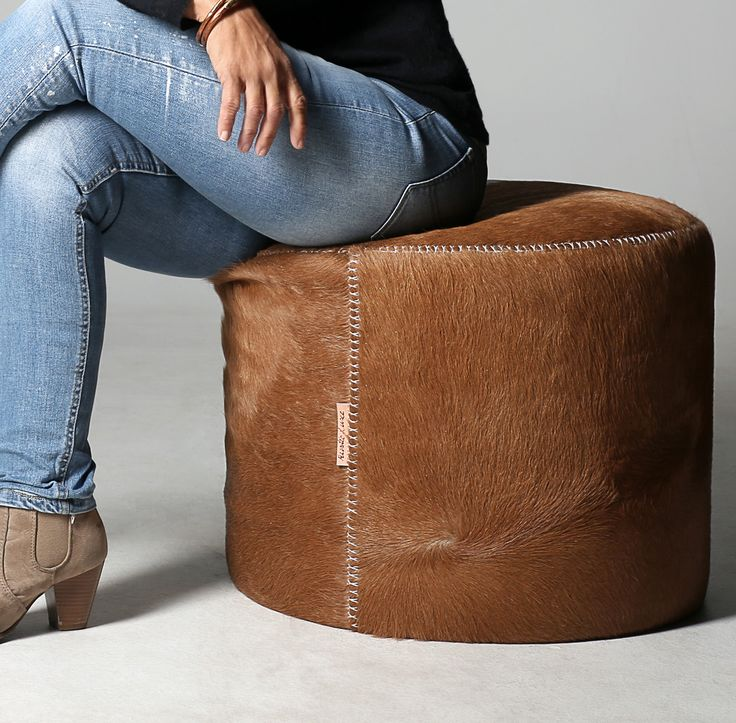 Hand stitched cowhide ottoman