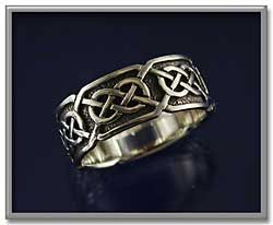 """Síorghrá"" Celtic Ring - ""Síorghrá"" can be translated from the Irish Gaelic as ""Eternal Love"". At approximately 3/8"" wide, this ring is beautifully suited for both male and female hands. Made of sterling silver."