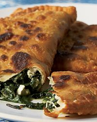 Jacques Pépin ordered a saiti, a turnover filled with tangy wild greens and feta, at Marianthi tavern in the Greek village of Monemvasía. This recipe is a close approximation. The olive oil in the dough (adapted from a recipe by Diane Kochilas) makes the crust extraordinarily flaky.