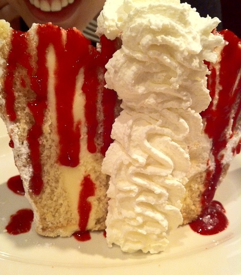 italian creme cake from bucca di beppo. almond lemon cake layered with lemon mouse and raspberry drizzle