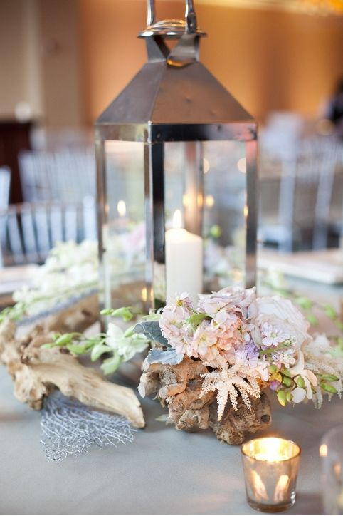 Lantern Centerpieces With Driftwood And White Blush Lavender Florals