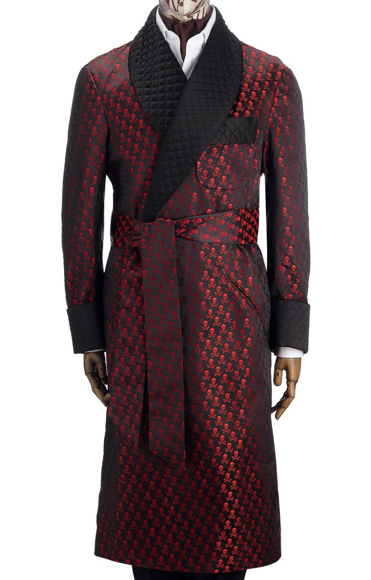 This flamboyant gown is made in an exclusive English woven silk. The gown features our signature Skull & Crossbones design whose origin is found in the history of one of Eton's many societies. Fully-lined in red silk featuring a piped quilted collar and cuffs, it has slash pockets, an out breast welt and deep gauntlet cuffs. Made in England.