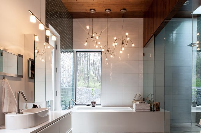 Walnut ceiling, limestone tiles and white quartz countertops.  Like the chandelier too.  A well designed bathroom.