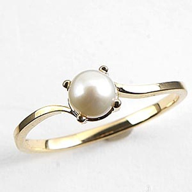 pearl engagement ring - love! I'm not into diamonds. or gold. but I like this design