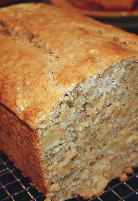 "Tropical Pineapple Coconut Banana Bread ""I've made many kinds of banana bread recipes, but this remains my absolute favorite. It's also one of the more popular recipes on my blog. If you're looking for a very moist, dense cake with loads of bananas… this is your recipe. Add some extra tropical flavors like pineapple, cream of coconut and macadamia nuts and you'll be in heaven!"""