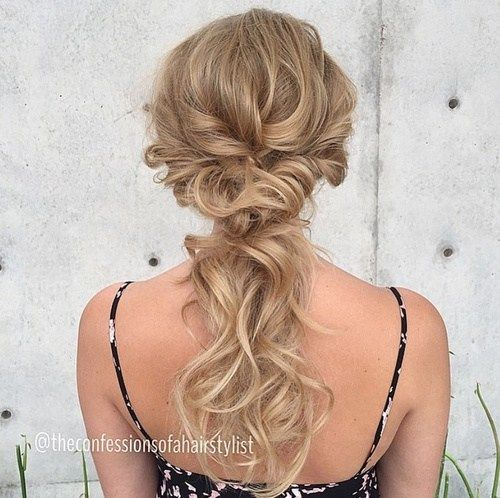 Reminds me of your hair, Sarah!  cute curly updo ponytail