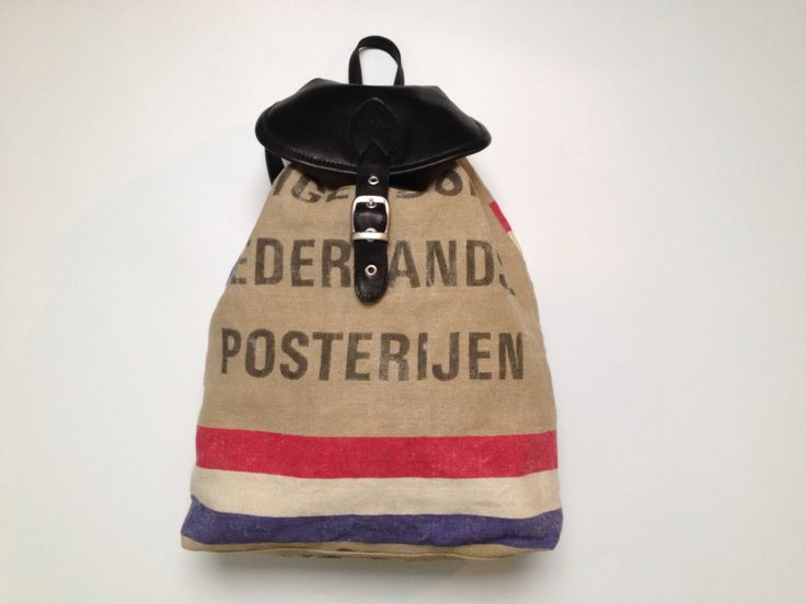 Backpack, made of an old Dutch postbag and black leather. Lined with an old sail of the sailboat.