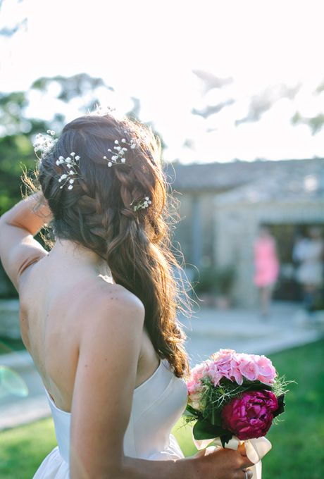 Brides.com: 21 Wedding-Ready Braids. Long, Loose Braids  This soft style, comprised of loose braids, is pulled back into an unstructured side ponytail.  See more wavy wedding hairstyles.