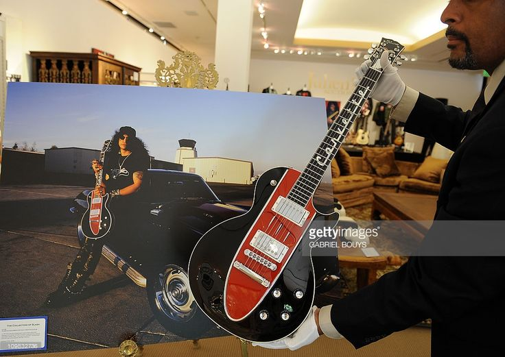 A Gibson Les Paul Corvette guitar is on display during the preview of the sale of exclusive property from legendary guitarist and musician Slash at Julien's Auctions in Beverly Hills, California on March 7, 2011. Included in the auction sale are some of the iconic, Grammy-winning, rock guitarist and songwriter's famous guitars, memorabilia, vehicles and personal furniture and décor from his Hollywood Hills residence.