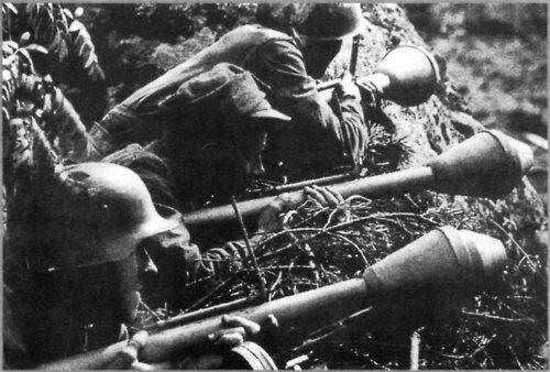 Finnish soldiers lying in wait with panzerfausts, June 1944. Continuation War