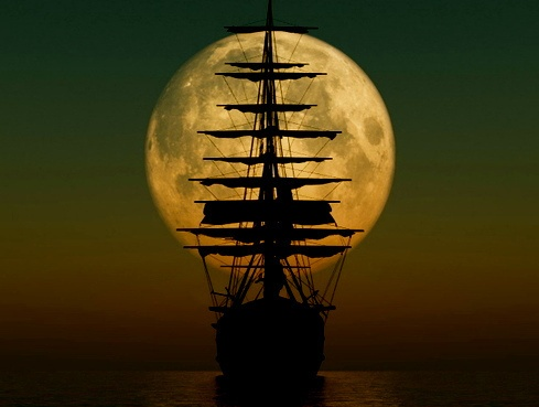 Ship sails by the moon
