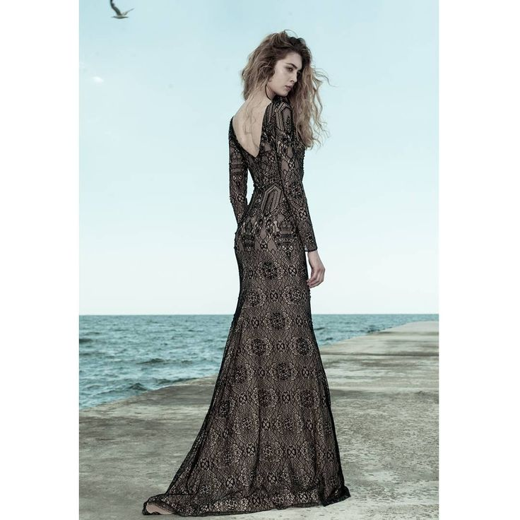 Nothing balances drama and glamour better than a figure-hugging open back mermaid silhouette bosting with Swarosvki black pearls. Ersa ateliee evening couture dress.