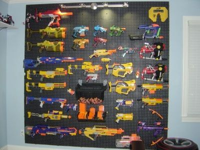 Nerf gun storage idea. Theirs is much smaller, but the boys love it!