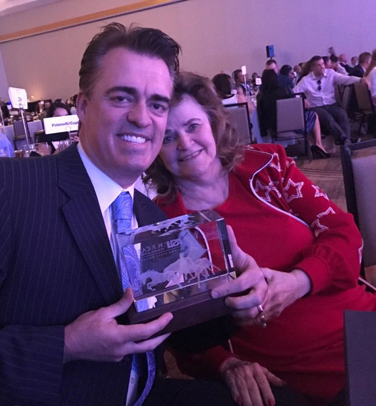 TASER CEO & co-founder with his mother. Patty Smith, after winning the ASU WP Carey Spirit of Enterprise BBVA Compass Innovation in Entrepreneurship Award 11/18/16.