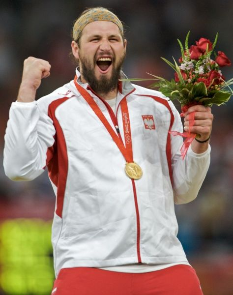 Tomasz Majewski from Poland becomes first thrower in nearly 60 years time to retain his shot put event title in Olympics. He grabbed the first gold medal in athletics of the London 2012 Games on Friday.