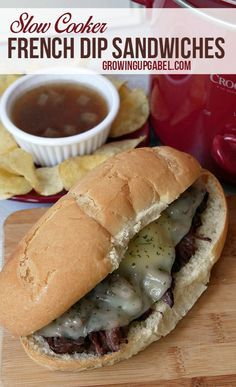 Slow cooker French dip sandwiches made with a chuck roast cooked all day in beef broth and red wine creates a delicious au jus. This easy recipe makes the BEST French dip you've ever had!
