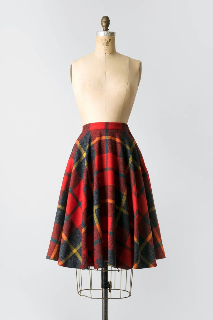 Vintage Wool Plaid Pendleton Circle Skirt  Circa 1950s - 1960s Fits like: Size XS Fabric: Pure Wool Label: Pendelton  Features: This true circle skirt is knee length and features a large, arched plaid print in a classic palette. Its made of high quality wool thats soft and moves