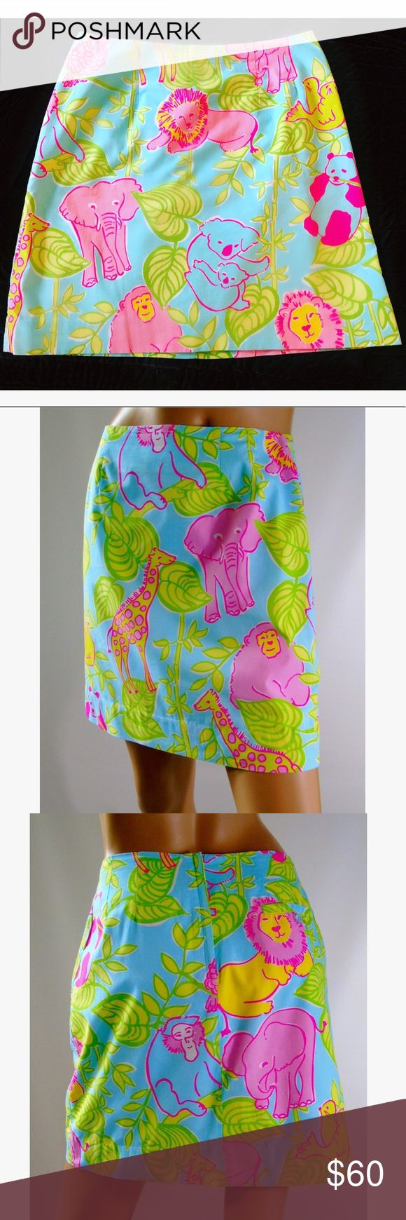 """Lilly Pulitzer Skirt. Blue San Diego Zoo Print Rare Lilly Pulitzer White Label Animals Skirt. Nassau Blue San Diego Zoo Print. Kohalas, Elephants, Lions, Pandas, Monkeys, Owls... Bamboo. Hidden Pocket, extra button inside lining, True to size! Waist: 15""""x2, Hips 20x2, Full length 18.5 No Stains, no Broken, no Flaws! I still love this skirt so it won't be easy to let it go... so no low bidders please  Lilly Pulitzer Skirts Mini"""