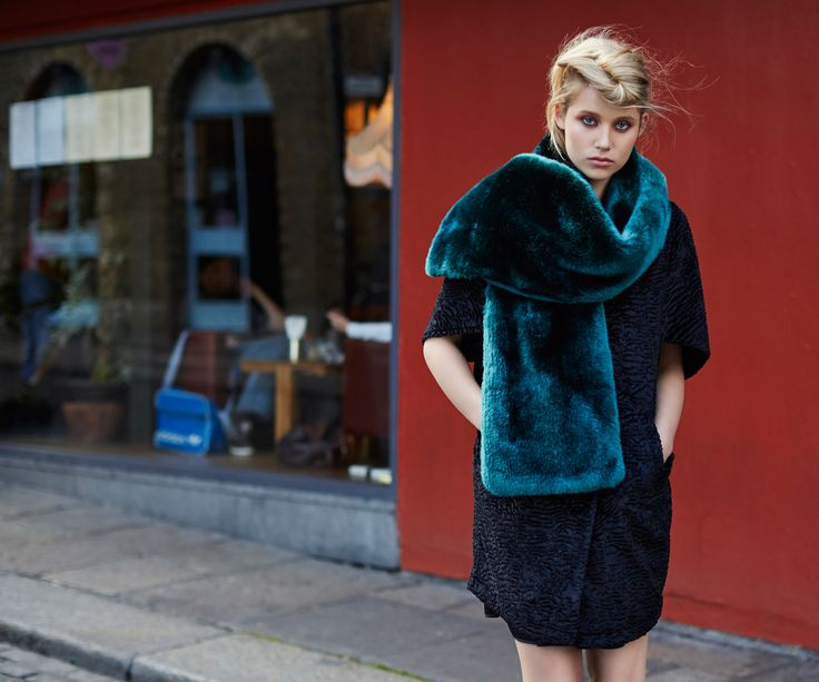 Blue faux-fur stole and short-sleeved, textured dress, both Savida by Dunnes Stores