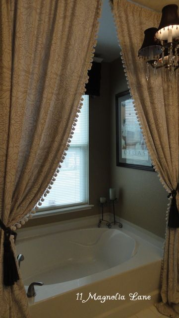 curtains give the tub area a cozy, luxurious feel. SOOO doing this!!!