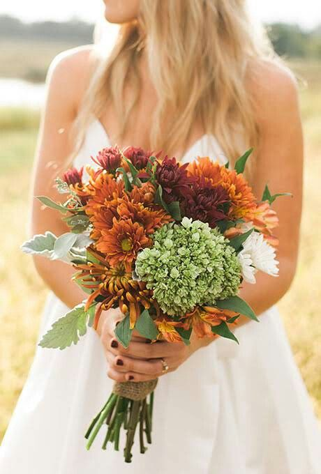 Rustic Autumn Wedding Bouquet Showcasing: Orange Alstroemeria, Yellow-Orange Spider Mums, Yellow/Orange Chrysanthemums, Rust Colored Chrysanthemums, White Chrysanthemums, Green Hydrangea, Dusty Miller + Green Foliage