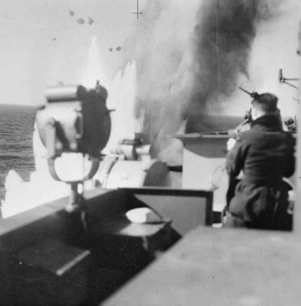 A near miss. HMS Illustrious attacked by dive bombers. 10 January 1941, in the mediterranean off the Italian island of Pantelleria. in the first action by German bombers in the mediterranean, HMS Illustrious survived a ferocious attack including that of over 40 ju-87's and ju-88's, to make it Malta.