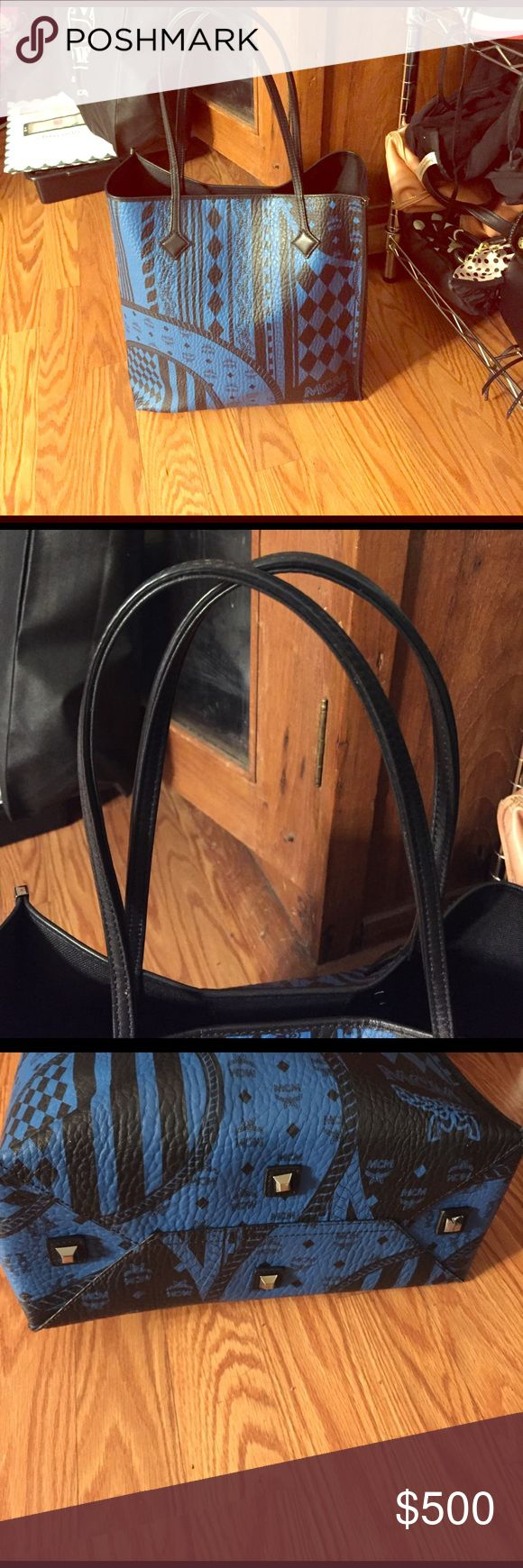 100% Authentic MCM tote bag It's a large blue MCM tote with MCM logo written all over it, no scratches or signs of wear. Basically brand new, Used only twice, holds a lot and also has a mini wallet that comes with it. Bought it at the MCM store in San Jose-please take a look and open to offers MCM Bags Totes