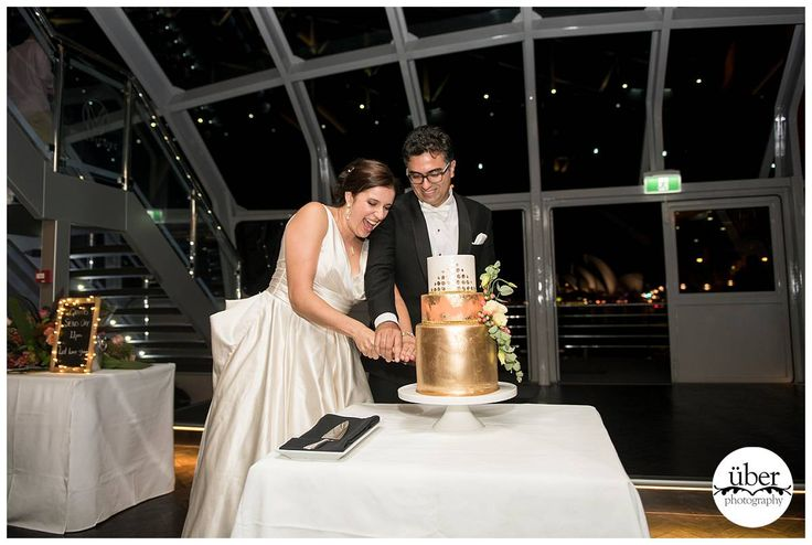 Cutting the cake with the lights of Sydney Harbour behind you......what beautiful memories. Photo by #Uberphotography
