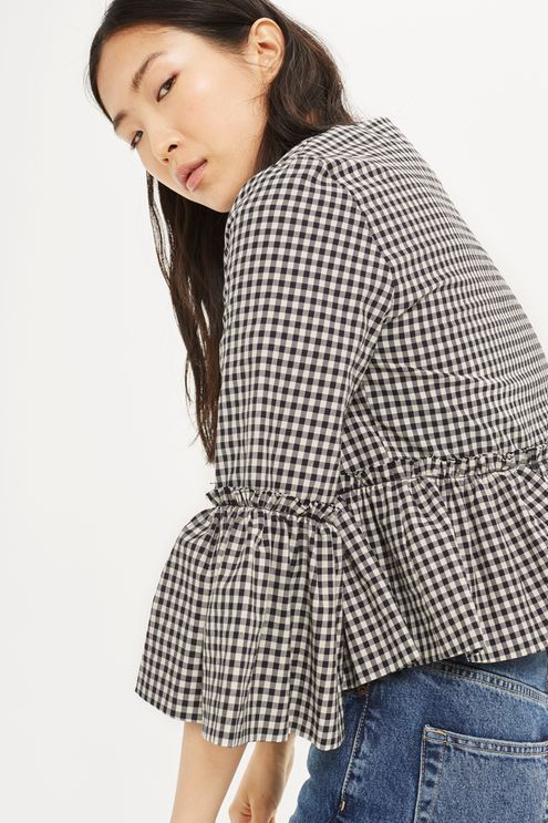 Add a pretty touch to your outer layers with this cropped jacket in gingham, featuring raw edge frill detail to the sleeves. Layer over a blouse and jeans combination to dress up a casual look.