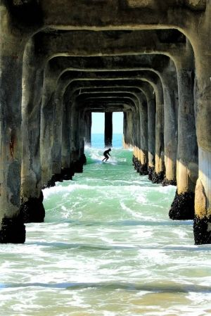 Pier surfing. I'm not sure whether or not this is a good idea