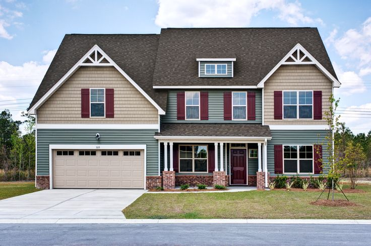 Grayson c exterior craftsman style home green and tan siding with red shutters and brick - Red exterior paint colors design ...