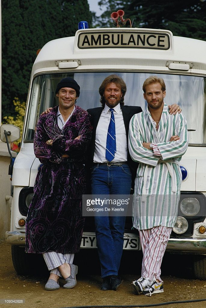 From left to right, actor Timothy Dalton, singer and songwriter Barry Gibb and actor Anthony Edwards on the set of the film 'Hawks', 1988. Gibb, a member of the Bee Gees, wrote and performed the soundtrack to the film.