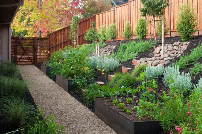 7 Simple And Stylish Tricks Can Change Your Life Backyard Garden Landscape Simple Tiered Herb Garden Sloped Backyard Landscaping Sloped Backyard Sloped Garden
