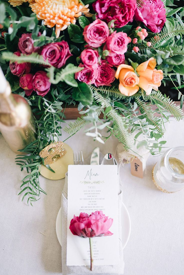 Pink and orange wedding centrepiece | Ben Yew Photography | See more: http://theweddingplaybook.com/20-wedding-reception-ideas-that-will-wow-your-guests/