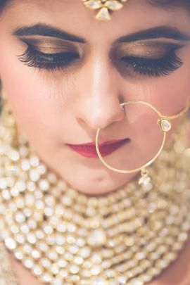 Indian Bridal Makeup - Bronze Bridal Eye Makeup with Plum Colored Lips and Extended Eyelashes | WedMeGood #wedmegood #makeup