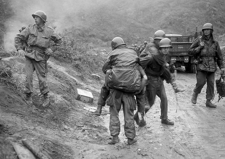 . American soldiers are carried on the backs of other GI's from Heartbreak Ridge through the rain to an aid station just behind the front lines in South Korea during the Korean War. The 2nd Division GI's, wounded in an ambush as they came off the Ridge for a two-day rest, had spent two weeks in the line during the height of the bloody battle on the east central front. (AP Photo)