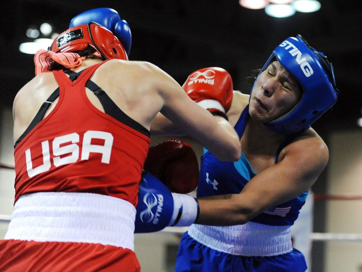 Mikaela Mayer, left, and Jajaira Gonzalez fight during the lightweight bout of the women's U.S. Olympic boxing team trials in Memphis, Tenn.  Christopher Hanewinckel, USA TODAY Sports