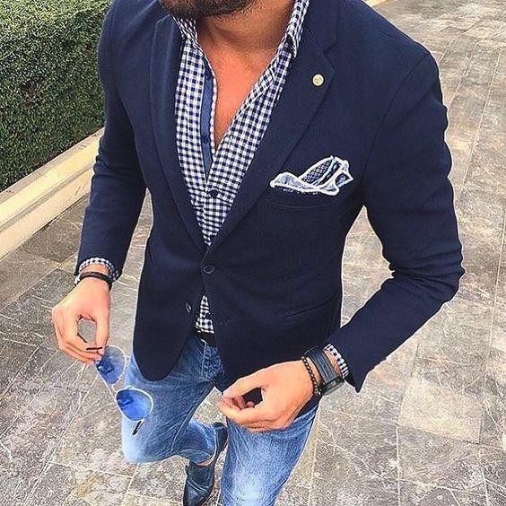 Shop this look on Lookastic: https://lookastic.com/men/looks/blazer-long-sleeve-shirt-skinny-jeans/19485 — White and Navy Gingham Long Sleeve Shirt — Navy Wool Blazer — Black Watch — Black Leather Belt — Blue Sunglasses — Black Leather Double Monks — Blue Skinny Jeans