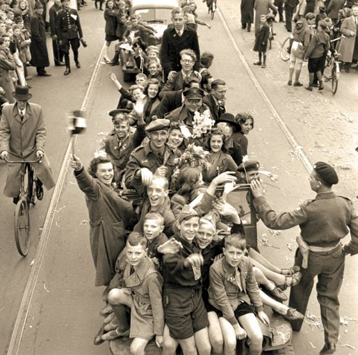 Joyful Dutch civilians and Canadian soldiers celebrate the liberation of Utrecht, May 7, 1945.