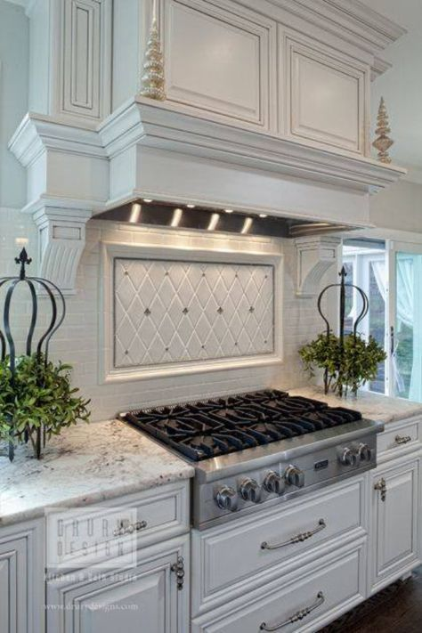 Kitchen DAC:  I also like the look of these cabinets. I really love the hood over the stovetop (or range), as well as, the back splash.