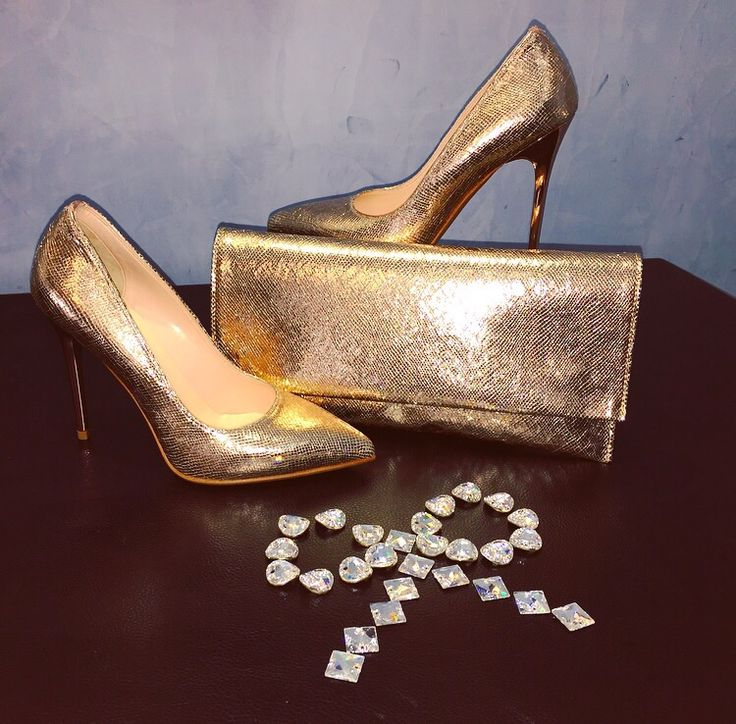 Gold is color of glamour! Discorre Decolletè and Pochette by Albano!!