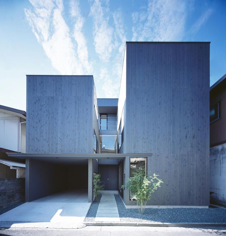 Home divided into two: area where each person spends time alone and where family gather - CAANdesign | Architecture and home design blog