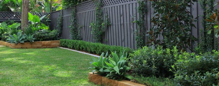 Lush plantings and natural sandstone garden walls