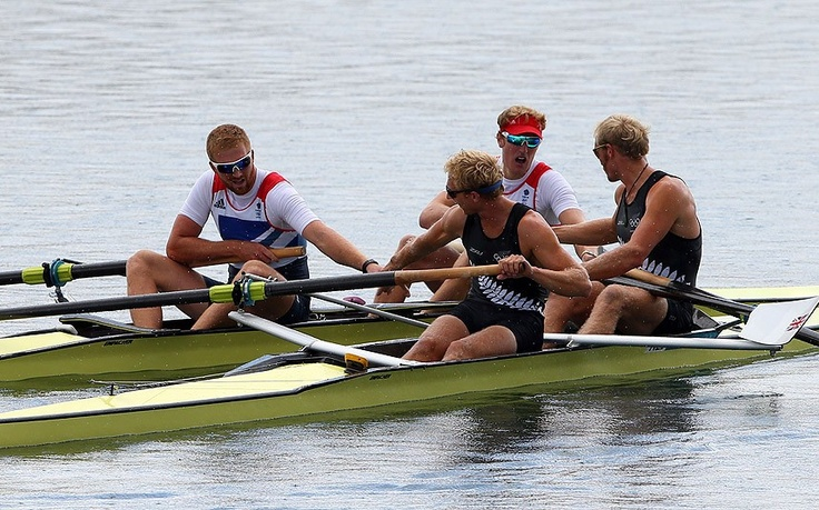 Hamish Bond and Eric Murray of New Zealand are congratulated by William Satch and George Nash of Great Britain as they celebrate winning gold in the Men's Pair final on Day 7 of the London 2012 Olympic Games