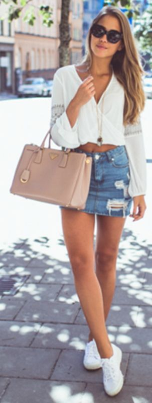 Distressed and frayed denim skirts + Kenza Zouiten + cute vintage style skirt + cropped white blouse + sneakers + easy and stylish summer look Skirt: Asos, Top: H&M, Shoes: Superga, Bag: Prada.