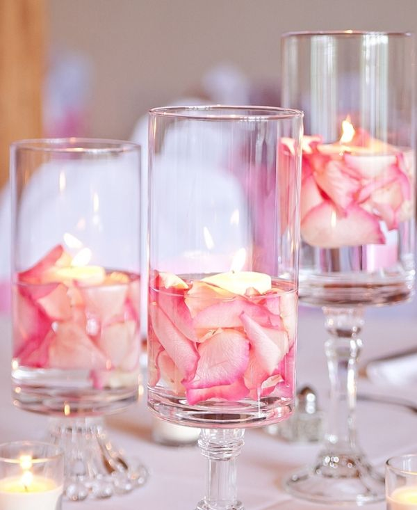 This whimsical centerpiece is inexpensive and oh-so-easy. Make hurricanes out of vases and candlesticks (or buy them) and fill them with water, rose petals, and a floating candle.