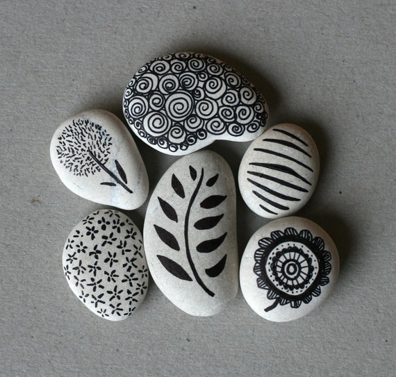 Use a perminant felt tip pen like a sharpie and draw patterns on smooth pebbles