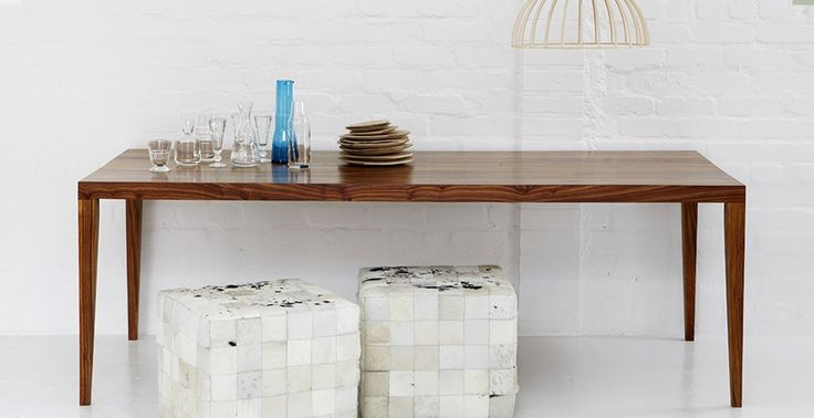 Tapered Leg Wooden Dining Table with leather ottomans by Klooftique