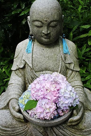 Jizo - guardian deity of children holding hydrangeas